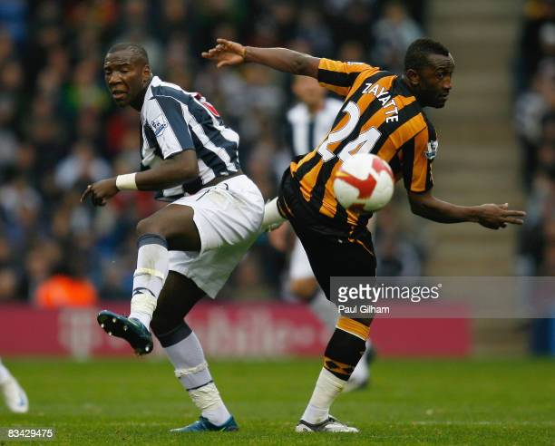 Ishmael Miller of West Bromwich Albion battles for the ball with Kanil Zayette of Hull City during the Barclays Premier League match between West...