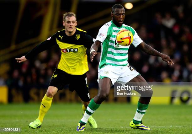Ishmael Miller of Yeovil holds off pressure from Joel Ekstrand of Watford during the Sky Bet Championship match between Watford and Yeovil Town at...