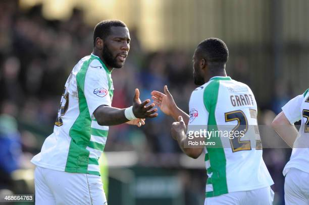 Ishmael Miller of Yeovil Town is congratulated by Joel Grant of Yeovil Town after scoring the opening goal during the Sky Bet Championship match...