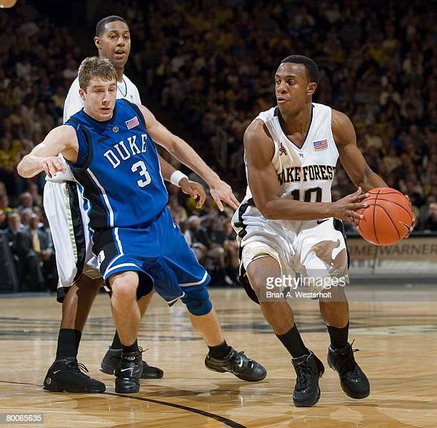 Ishmael Smith of the Wake Forest Demon Deacons drives past Greg Paulus of the Duke Blue Devils at the LJVM Coliseum on February 17 2008 in...