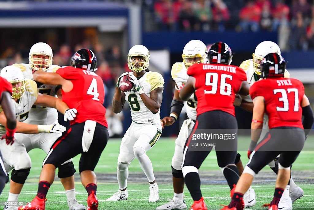 Ishmael Zamora #8 of the Baylor Bears looks to pass during the game against the Texas Tech Red Raiders on November 25, 2016 at AT&T Stadium in Arlington, Texas. Texas Tech defeated Baylor 54-35.