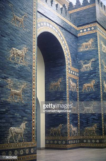 Ishtar Gate through which ran a processional road One of 8 fortified gates of Nebuchandrezzar's city of Babylon it was decorated with dragons and...