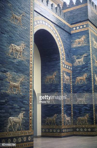 Ishtar Gate through which ran processional road One of 8 fortified gates of Nebuchadrezzar's city of Babylon it was decorated with dragons and _young...