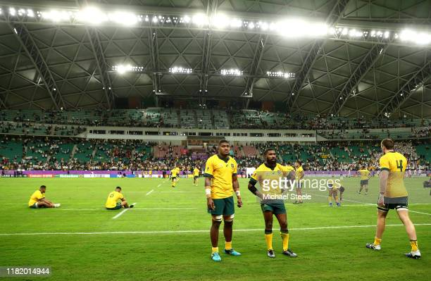 Isi Naisarani and Marika Koroibete of Australia look dejected following defeat in the Rugby World Cup 2019 Quarter Final match between England and...