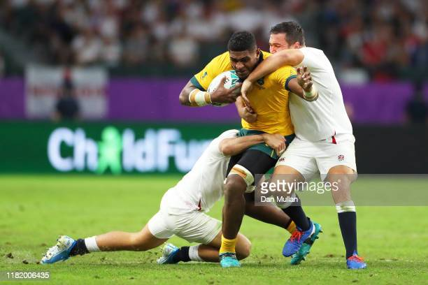 Isi Naisarani of Australia is tackled by Jonny May and Jamie George of England during the Rugby World Cup 2019 Quarter Final match between England...