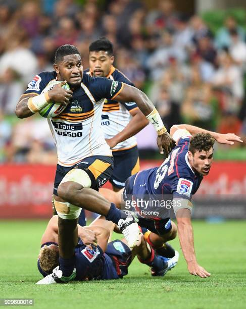 Isi Naisarani of the Brumbies breaks through a tackle during the round four Super Rugby match between the Rebels and the Brumbies at AAMI Park on...