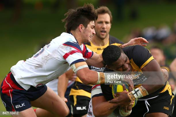 Isi Naisarani of the Spirit gets tackled Jack Maddocks and Sione Tuipulotu of the Rising during the round one NRC match between Perth Spirit and...