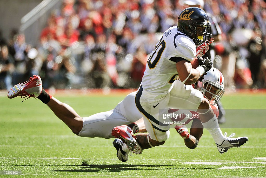 Isi Sofele #20 of the California Golden Bears is tripped up by Ryan Shazier #10 of the Ohio State Buckeyes after catching a pass in the second half at Ohio Stadium on September 15, 2012 in Columbus, Ohio.