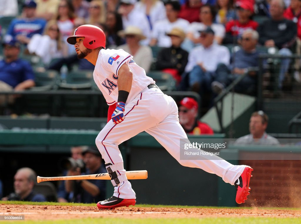 Isiah Kiner-Falefa #9 of the Texas Rangers drops his bat on the way to first after hitting a two-run double in the eighth inning against the Seattle Mariners at Globe Life Park in Arlington on April 22, 2018 in Arlington, Texas.