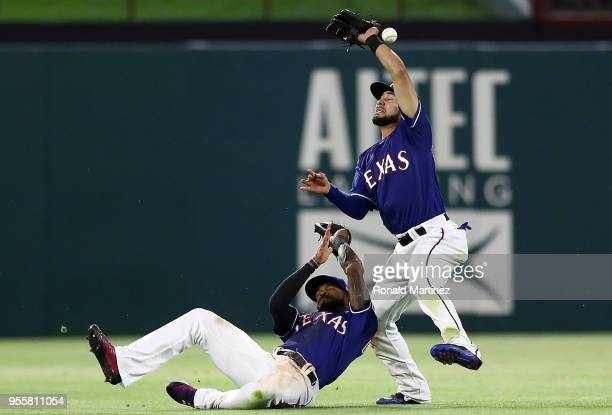 Isiah KinerFalefa of the Texas Rangers drops the ball as Delino DeShields slides underneath in the eighth inning at Globe Life Park in Arlington on...