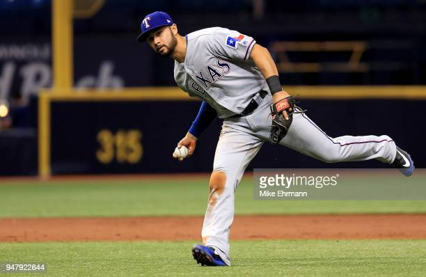 Isiah KinerFalefa of the Texas Rangers fields a ground ball during a game against the Tampa Bay Rays at Tropicana Field on April 17 2018 in St...