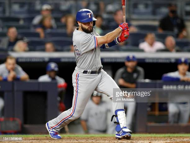 Isiah Kiner-Falefa of the Texas Rangers follows through on a fifth inning RBI double against the New York Yankees at Yankee Stadium on September 20,...