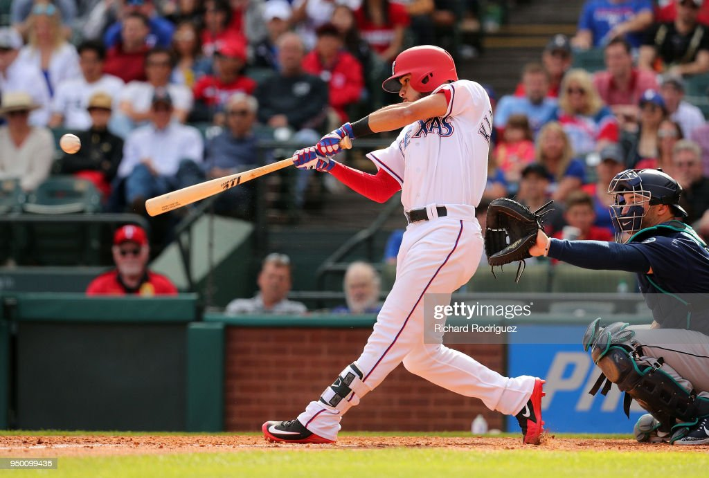 Isiah Kiner-Falefa #9 of the Texas Rangers gets a hit that scores two runs in the at Globe Life Park in Arlington on April 22, 2018 in Arlington, Texas.