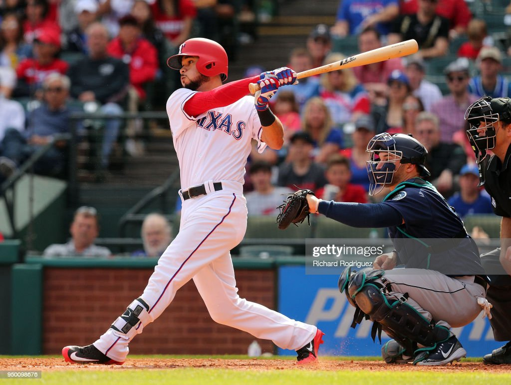 Isiah Kiner-Falefa #9 of the Texas Rangers hits a two run double in the eigth inning against the Seattle Mariners at Globe Life Park in Arlington on April 22, 2018 in Arlington, Texas.