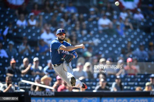 Isiah KinerFalefa of the Texas Rangers throws to first base during the sixth inning of the game against the San Diego Padres at PETCO Park on...