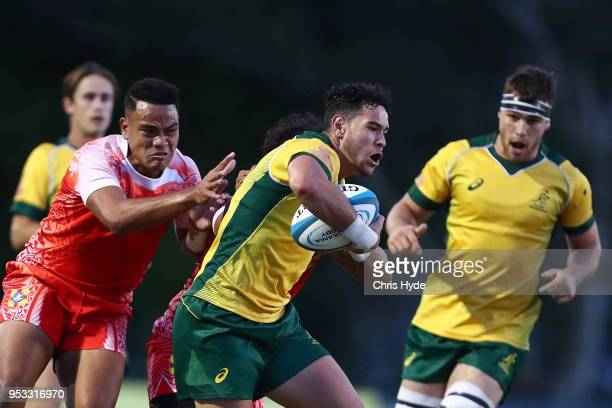 Isiah Latu of Australia makes a break during the 2018 Oceania Rugby U20 Championship match between Australia and Tonga at Bond University on May 1...