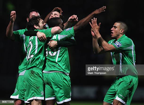 Isiah Rankin of Forest Green Rovers celebrates his goal with his team mates during the FA Cup sponsored by EON 3rd Round match between Notts County...