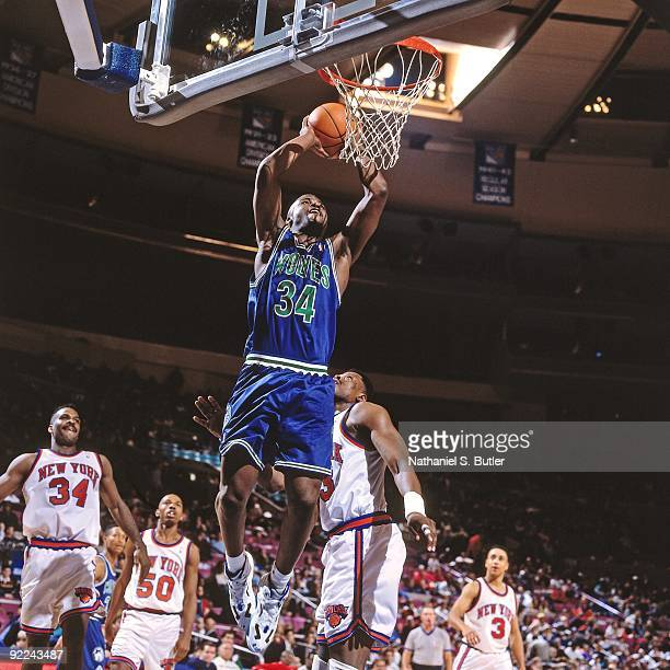 Isiah Rider of the Minnesota Timberwolves dunks against Patrick Ewing of the New York Knicks during a game played on January 17 1994 at Madison...