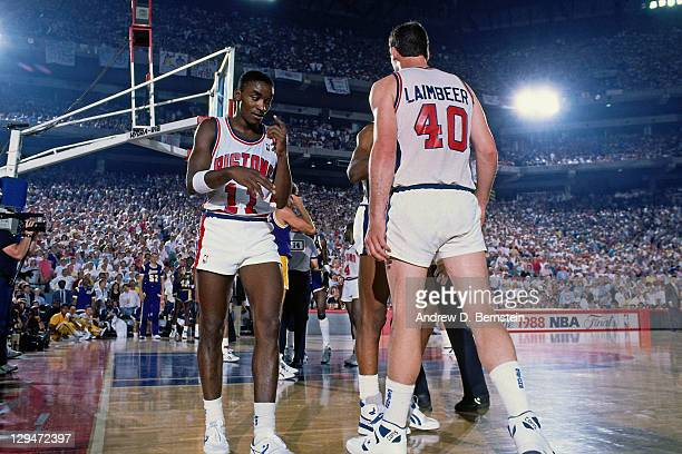 Isiah Thomas and Bill Laimbeer of the Detroit Pistons talk during Game Four of the 1988 NBA Finals on June 14 1988 at the Pontiac Silverdome in...