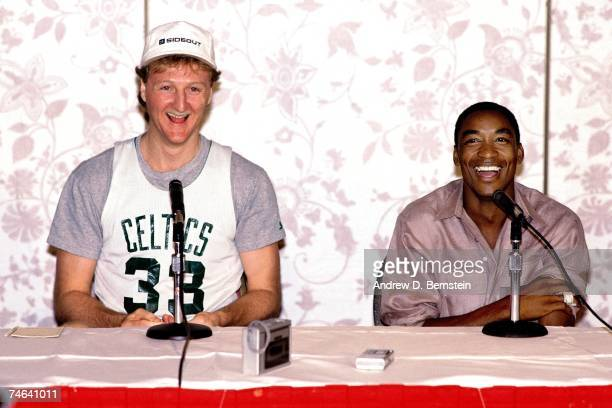 Isiah Thomas of the Detroit Pistons and Larry Bird of the Boston Celtics talk with the media during a 1986 press conference NOTE TO USER User...