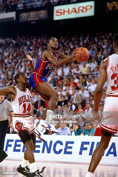 Isiah Thomas of the Detroit Pistons attempts a layup against the Chicago Bulls during a 1989 NBA game at the United Center in Chicago Illinois NOTE...