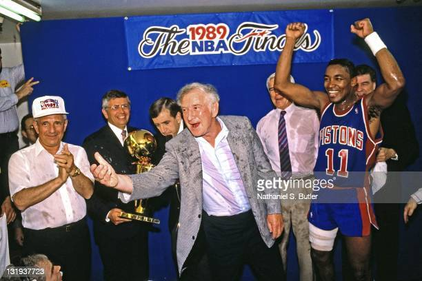Isiah Thomas of the Detroit Pistons celebrates after defeating the Los Angeles Lakers in four games to win the NBA Championship on June 13 1989 at...