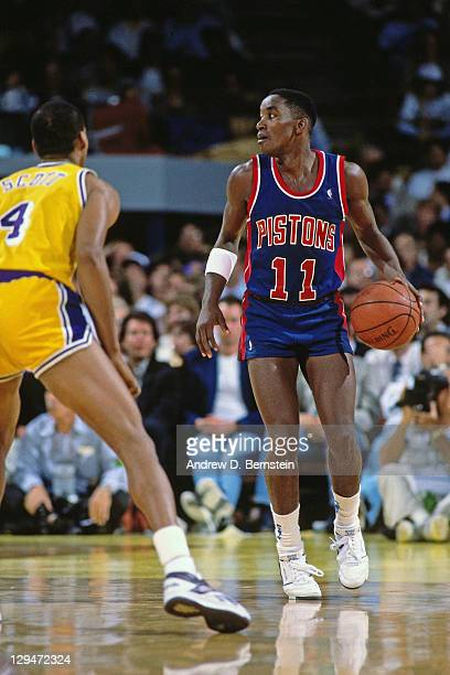 Isiah Thomas of the Detroit Pistons dribbles against Byron Scott of the Los Angeles Lakers during Game One of the 1988 NBA Finals on June 7 1988 at...