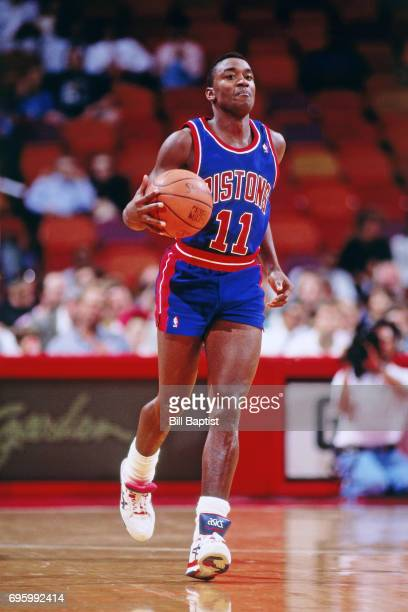 Isiah Thomas of the Detroit Pistons dribbles against the Houston Rockets during a game played circa 1990 at the Summit in Houston Texas NOTE TO USER...