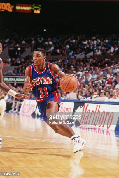 Isiah Thomas of the Detroit Pistons dribbles against the New York Knicks during a game played circa 1993 at the Madison Square Garden in New York...