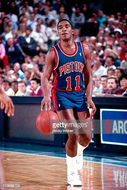 Isiah Thomas of the Detroit Pistons dribbles against the Sacramento Kings during a game played on February 23 1988 at Arco Arena in Sacramento...