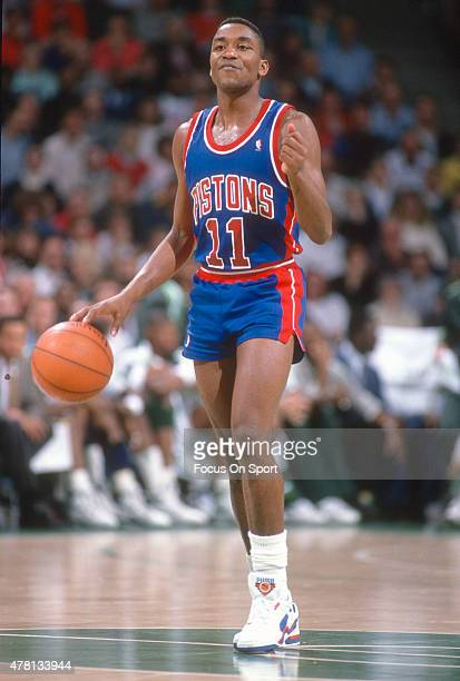 Isiah Thomas of the Detroit Pistons dribbles the ball against the Milwaukee Bucks during an NBA basketball game circa 1990 at The Bradley Center in...