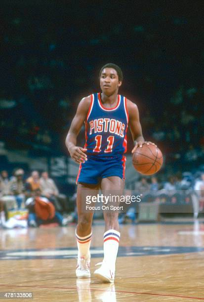 Isiah Thomas of the Detroit Pistons dribbles the ball up court against the Washington Bullets during an NBA basketball game circa 1982 at The Capital...
