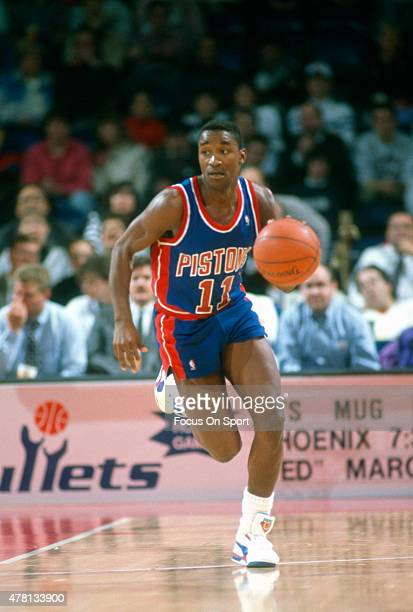 Isiah Thomas of the Detroit Pistons dribbles the ball up court against the Washington Bullets during an NBA basketball game circa 1990 at The Capital...