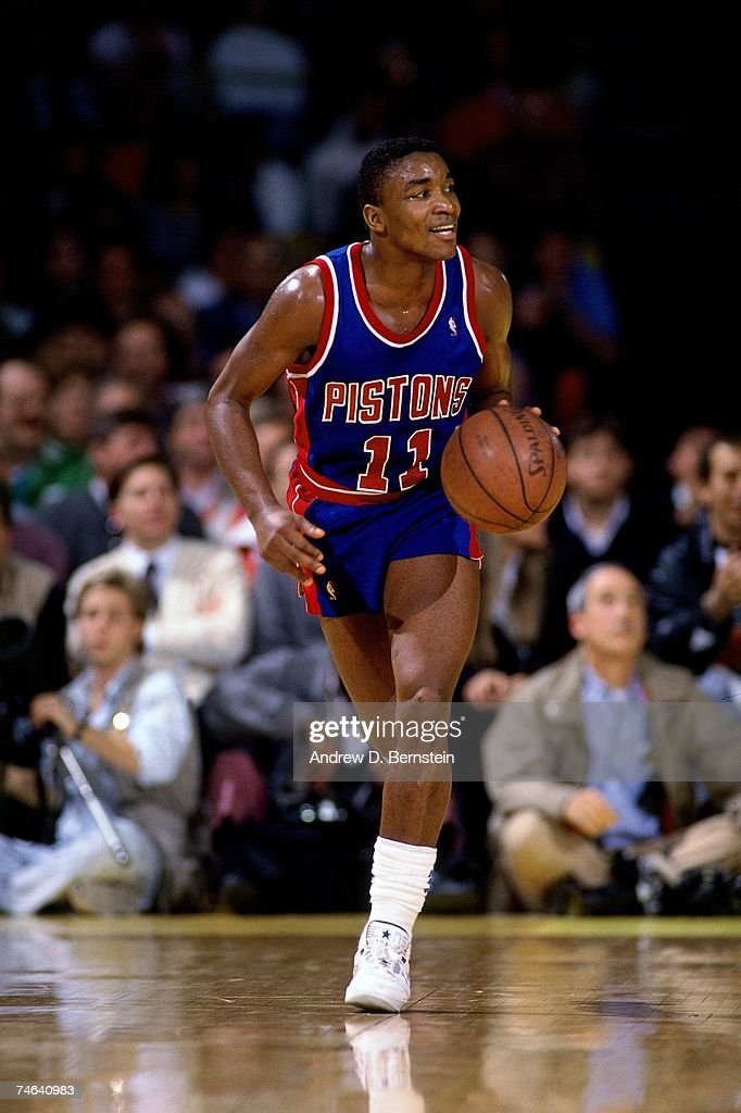 Isiah Thomas #11 of the Detroit Pistons dribbles up court during a 1989 NBA game.