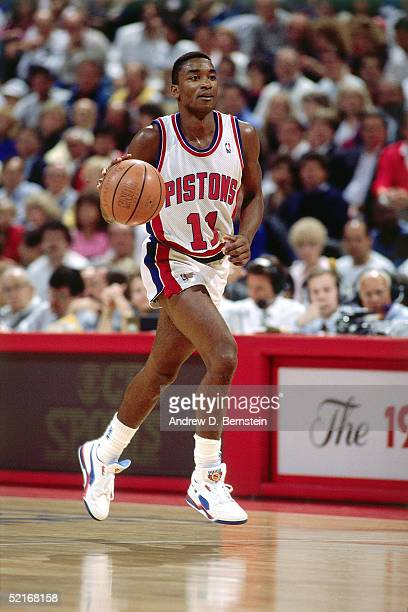 Isiah Thomas of the Detroit Pistons dribbles up court during an NBA game in 1989 at The Palace in Auburn Hills Michigan NOTE TO USER User expressly...