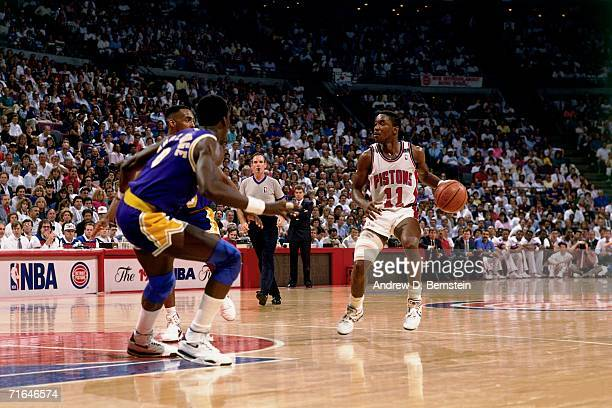 Isiah Thomas of the Detroit Pistons dribbles upcourt against the Los Angeles Lakers during the 1989 NBA Finals at the Palace of Auburn Hills in...