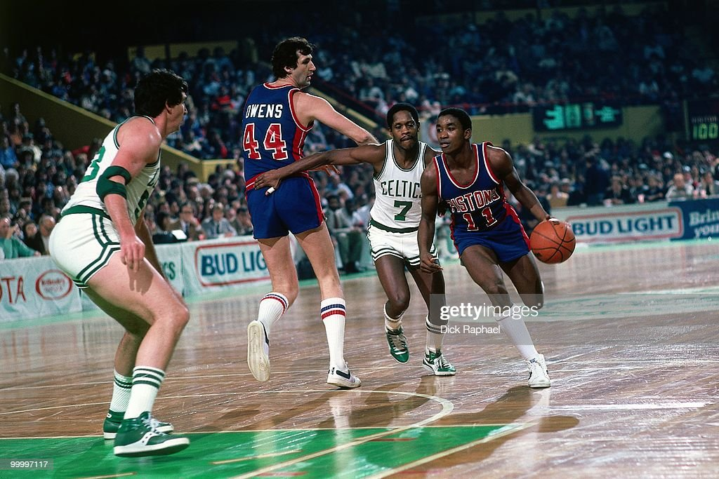 Isiah Thomas #11 of the Detroit Pistons drives the ball up court against the Boston Celtics during a game played in 1983 at the Boston Garden in Boston, Massachusetts.