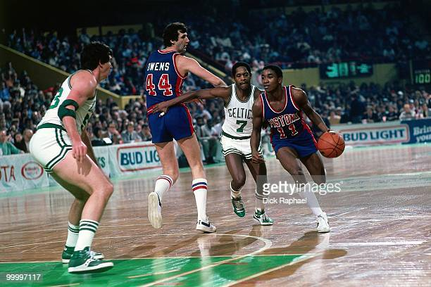 Isiah Thomas of the Detroit Pistons drives the ball up court against the Boston Celtics during a game played in 1983 at the Boston Garden in Boston...
