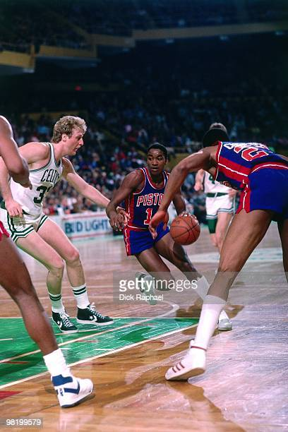 Isiah Thomas of the Detroit Pistons drives to the basket against Larry Bird of the Boston Celtics during a game played in 1985 at the Boston Garden...
