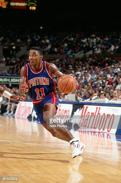 Isiah Thomas of the Detroit Pistons drives to the basket against the New Jersey Nets during an NBA game circa 1993 at the Brendan Byrne Arena in East...
