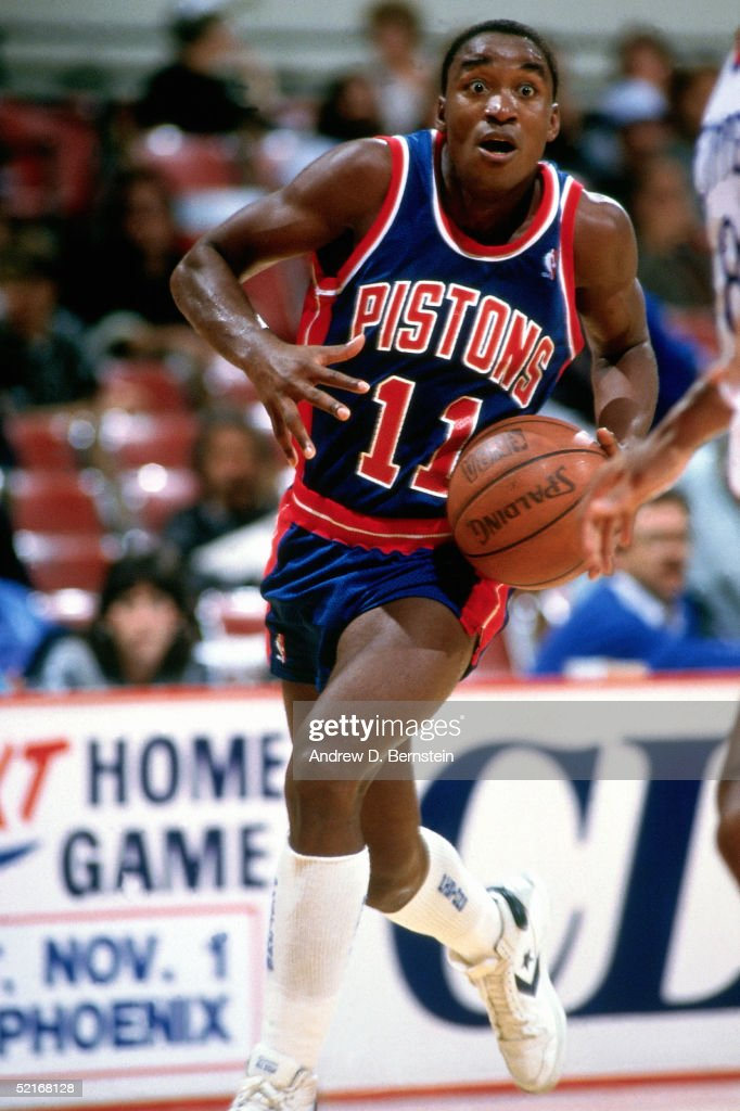Isiah Thomas #11 of the Detroit Pistons drives to the basket during an NBA game in 1986.