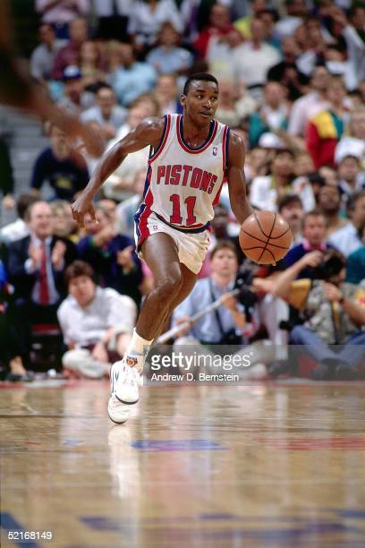 Isiah Thomas of the Detroit Pistons drives to the basket during an NBA game in 1989 at The Palace in Auburn Hills Michigan NOTE TO USER User...