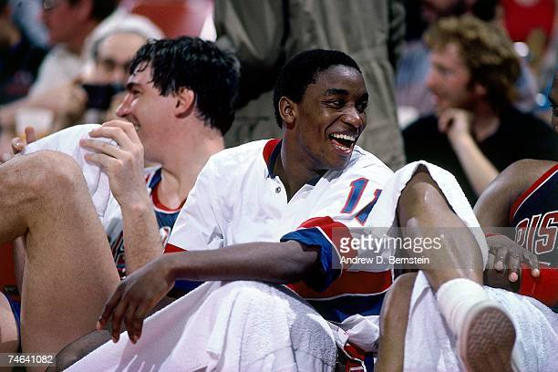 Isiah Thomas of the Detroit Pistons has a laugh on the bench during a 1984 NBA game at the Palace of Auburn Hills in Detroit Michigan NOTE TO USER...
