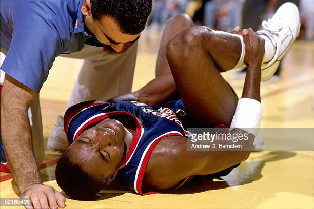 Isiah Thomas of the Detroit Pistons lays on the court in pain after injuring his ankle circa 1988 during an NBA game NOTE TO USER User expressly...