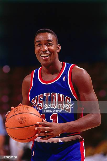 Isiah Thomas of the Detroit Pistons looks on against the Sacramento Kings during a game played on March 14 1992 at Arco Arena in Sacramento...