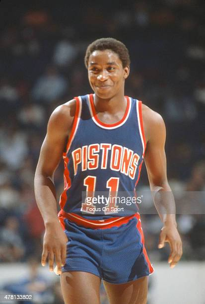 Isiah Thomas of the Detroit Pistons looks on smiling against Washington Bullets during an NBA basketball game circa 1982 at The Capital Centre in...