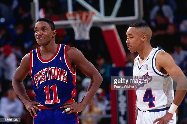 Isiah Thomas of the Detroit Pistons looks on with Spud Webb of the Sacramento Kings during a game played on March 16 1993 at Arco Arena in Sacramento...