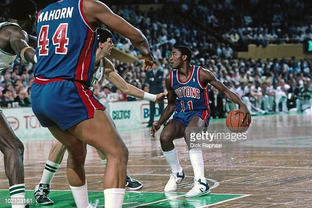 Isiah Thomas of the Detroit Pistons looks to make a play against the Boston Celtics during a game played in 1987 at the Boston Garden in Boston...