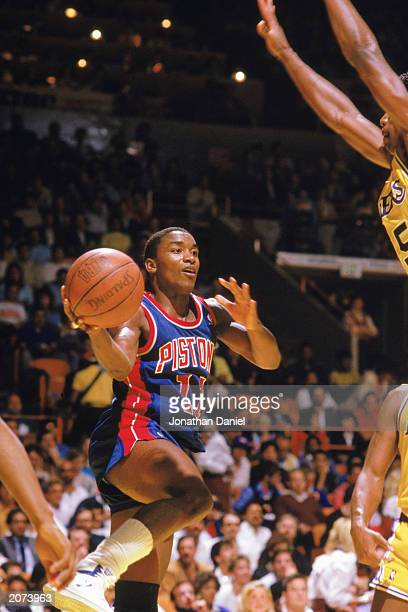 Isiah Thomas of the Detroit Pistons looks to pass in a game against the Los Angeles Lakers at the Great Western Forum in Los Angeles California...