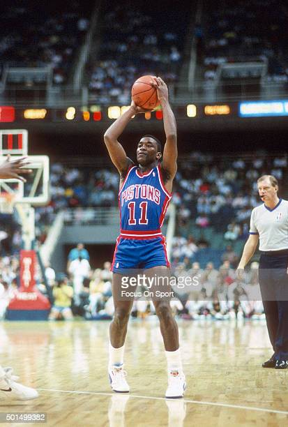 Isiah Thomas of the Detroit Pistons looks to pass the ball against the Miami Heat during an NBA basketball game circa 1989 at the Miami Arena in...